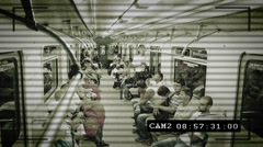 CCTV camera in subway train, people being watched, big brother Stock Footage
