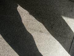 Shadow of a man`s legs Stock Photos