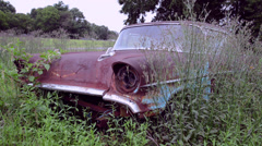 Antique chevy car sits in field Stock Footage