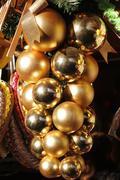 Decorative cluster of golden christmas balls Stock Photos