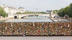 Stock Photo of paris - july 27: lockers at pont des arts symbolize love for ever, july 27, 2
