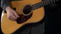 Musician playing Acoustic Guitar- Musical Instruments Stock Footage
