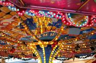 Stock Photo of funfair / kermis / merry-go-rounds carousel lights