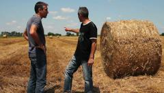 Two Farmers Talking Stock Footage