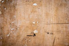 wood texture with cracks and the remnants of the old paper - stock photo