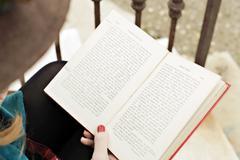 Romantic girl reading a book - stock photo