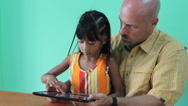 Stock Video Footage of Father And Daughter Playing Game On Digital Tablet