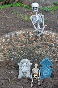 Halloween skeletons and tombstones Stock Photos