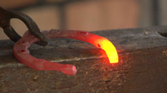 Blacksmith forges a horseshoe, slow motion 1 Stock Footage