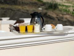 Tasty continental breakfast on terrace, pan shot NTSC Stock Footage