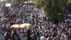 Crowd at country fair, time lapse medium, walking on midway. Evening MS Stock Footage