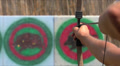 man shoots a bow at a target, Slow Motion 4 Footage