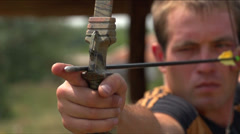 Man shoots a bow at a target, Slow Motion 3 Stock Footage