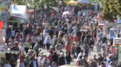 Crowd at county fair walking up Midway, soft focus Medium shot. Stock Footage
