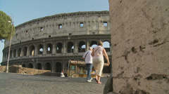 From behind wall to the Colosseum 1 (slomo dolly) Stock Footage