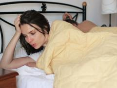 Couple having problems in bed, top view NTSC Stock Footage