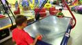 boys play air hockey 1 HD Footage