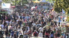 Stock Video Footage of Crowds at summer fair, slo motion walking up midway.  Daytime sunny.