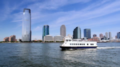 Hudson River Ferry with Jersey City Skyline Stock Footage