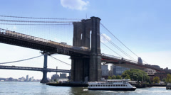 Passing Near The Brooklyn Bridge Spanning The East River - stock footage