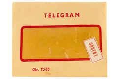 old telegram envelope with urgent mark - stock photo