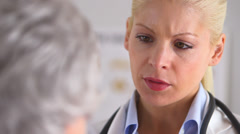 Close up of concerned doctor talking to patient Stock Footage
