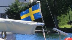 Swedish flag waves on boat Stock Footage