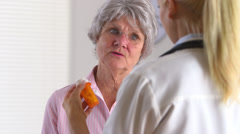 Elderly patient asking doctor about prescription medicine - stock footage