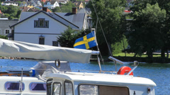 Swedish flag waves at Askersund Bay Stock Footage