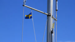 Swedish flag waves on sailboat mast Stock Footage