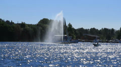 Tour boat circles water fountain on Askersund Bay - stock footage