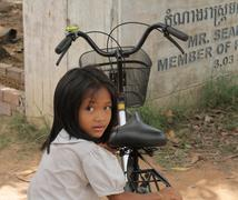 Cambodian Children - a young girl with her bike Stock Photos