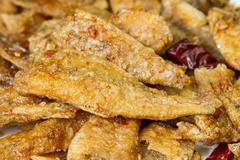 seasoning crispy fried fish - stock photo