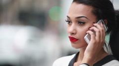 Beautiful woman talking on cellphone outdoor city street Stock Footage