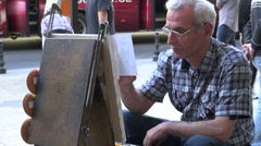 Street painter in Tbilisi, painting in the streets, artist, making a living Stock Footage