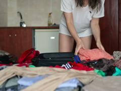 Woman hands packing suitcase NTSC - stock footage