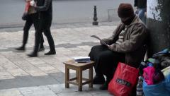 Tbilisi, woman reading book at street market, waiting for customers Stock Footage