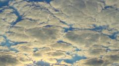 Cloud timelapse sun rays through cloudy sky Stock Footage