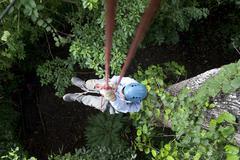 Woman climbing with the rope gandoca manzanillo costa rica Stock Photos