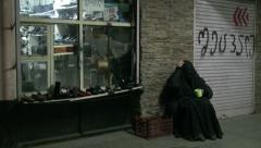 Tbilisi Georgia widow beggar veiled poverty poor lady black dress Stock Footage