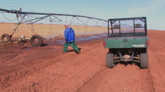 Farmer checks spray nozzle Stock Footage