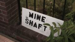 Mineshaft mine shaft entrance warning sign Stock Footage