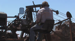 Ditch Witch operator at work Stock Footage