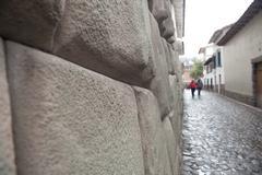 Old stonewall and tourist cuzco peru Stock Photos