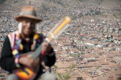 Guitar player in cuzco peru Stock Photos