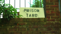 Prison yard sign Stock Footage