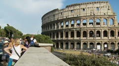 Tourists advantage point look at Colosseum 1 (slomo dolly) Stock Footage