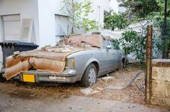 Lincoln town car 1981 is rotting away Stock Photos
