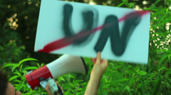 Anti UN protest sign Stock Footage