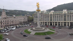 Freedom Square, roundabout traffic, government buildings, hotel, Tbilisi Georgia Stock Footage